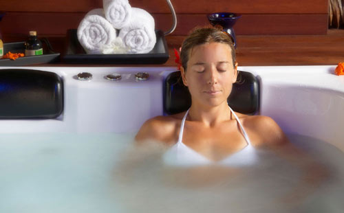 Woman relaxing in an Arctic Spa with Onzen feature
